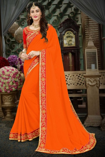 Graceful Orange Georgette Zari Work Designer Saree With Banglori Silk Blouse