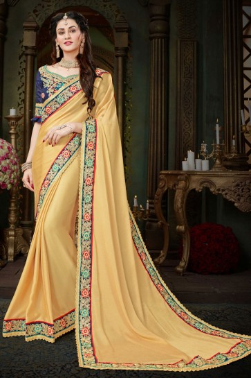Supreme Cream Georgette Zari Work Designer Saree With Banglori Silk Blouse