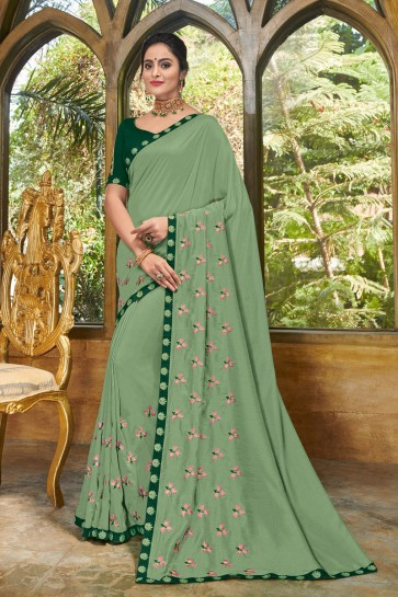 Gorgeous Green Georgette Embroidered Party Wear Saree With Silk Blouse