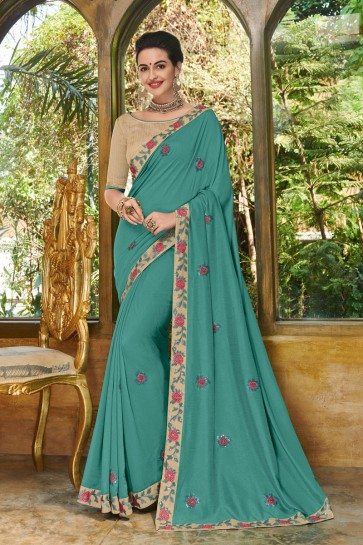 Optimum Teal Georgette Embroidered Party Wear Saree With Silk Blouse