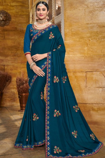 Pretty Teal Georgette Embroidered Party Wear Saree With Silk Blouse
