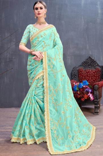 Beautiful Turquoise Coding And Sequence Embroidered Organza Saree With Silk Blouse