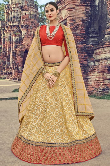 Beautiful Beige Jacquard Embroidered Designer Lehenga Choli With Net Dupatta