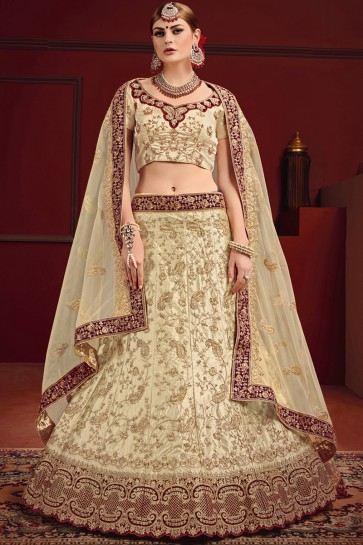 Beautiful Beige And Maroon Zari And Thread Work Lehenga Choli With Net Dupatta