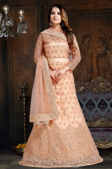 Solid Peach Gold Embroidered Net And Satin Lehenga Choli With Net Dupatta
