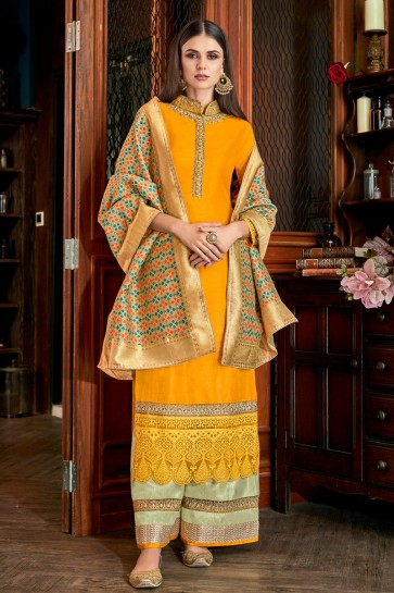 Delightful Yellow Embroidered And Lace Work Silk Plazzo Suit With Jacquard Dupatta