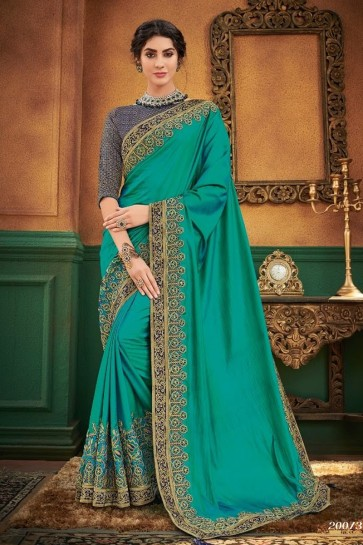 Net Fabric Embroidered Designer Teal Lovely Saree And Blouse