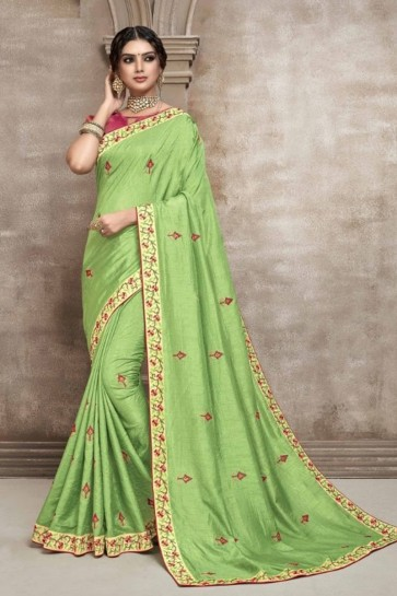 Silk Fabric Green Embroidered Designer Saree And Blouse