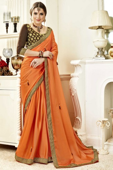 Stylish Orange Fancy Fabric Lace Work Party Wear Saree With Silk Blouse