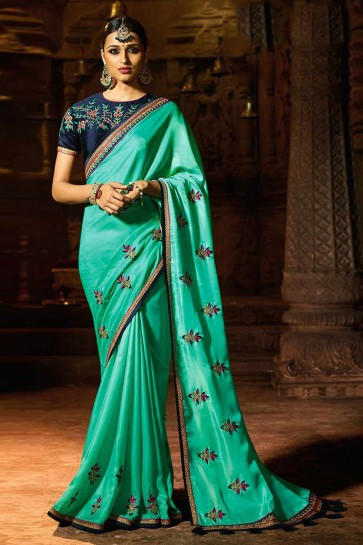 Charming Turquoise Silk Lace Work Saree With Silk Blouse