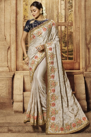 Sliver Border And Embroidery Work Satin Fabric Saree With Silk Blouse