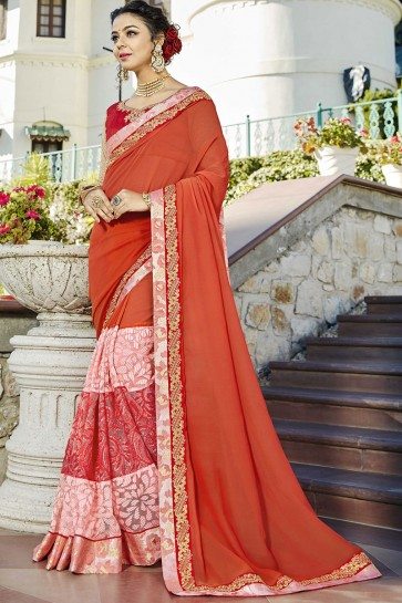 Fascinating Orange Wedding Wear Lace Work Fancy Fabric Saree