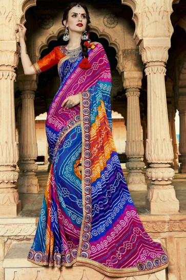 Fascinating Blue Pink and Orange Party Wear Lace Work Georgette Bandhej Print Saree