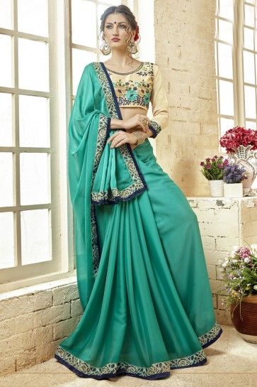 Lovely Turquoise Fancy Fabric Embroidered Saree With Fancy Fabric Blouse