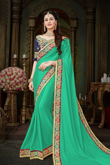 Desirable Teal Georgette Designer Embroidered Saree