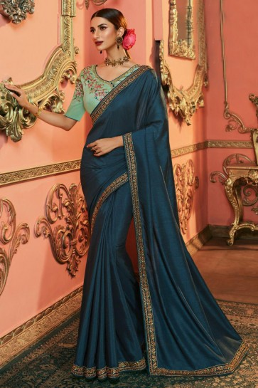 Desirable Teal Embroidered Silk Saree And Blouse