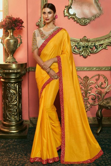 Stunning Yellow Embroidered Silk Saree And Blouse