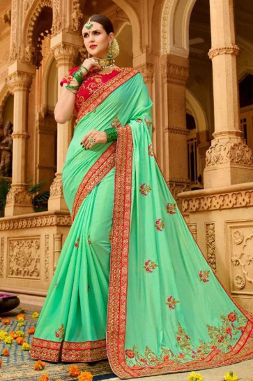 Supreme Turquoise Fancy Fabric Embroidered Saree With Fancy Fabric Blouse
