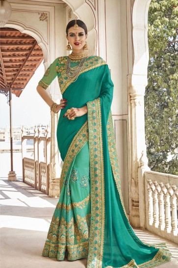 Graceful Turquoise Net and Georgette Embroidered Wedding Saree With Banglori Silk Blouse