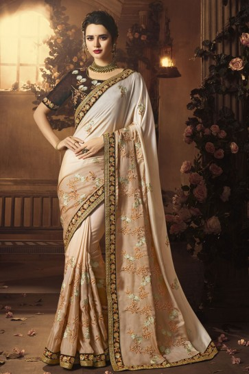 Charming Cream Silk Embroidered Saree With Silk Blouse