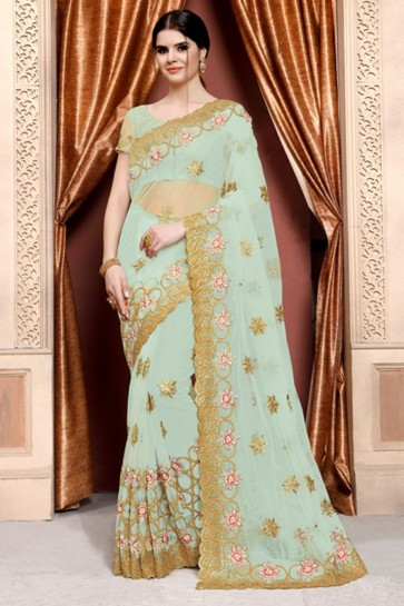 Gorgeous Turquoise Net Embroidered Designer Saree With Net Blouse