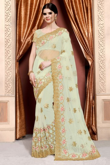 Excellent Turquoise Net Embroidered Designer Saree With Net Blouse