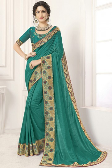 Delightful Lace Work And Border Work Sea Green Silk Saree And Blouse