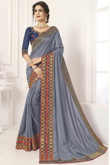 Fascinating Border Work And Lace Work Grey Silk Saree And Blouse
