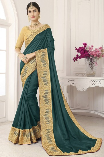 Marvelous Silk Border Work And Lace Work Teal Saree And Blouse