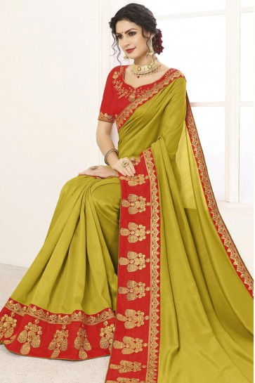 Superb Olive Silk Border Work And Lace Work Saree And Blouse