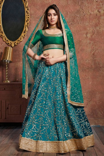 Turquoise Silk Sequins Work And Zari Work Lehenga Choli With Net Dupatta