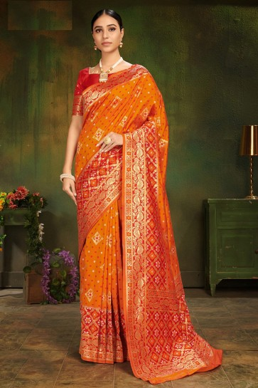 Jacquard Work And Weaving Work Orange Patola Silk Fabric Stylish Saree And Blouse