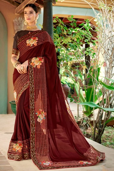 Pleasing Embroidred And Printed Brown Fancy Fabric Saree And Silk Blouse