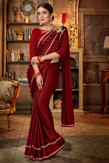 Pretty Embroidred And Lace Work Maroon Satin And Silk Flare Saree With Banglori Silk Blouse