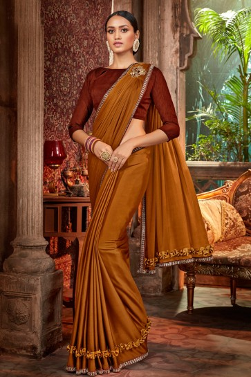 Appealing Coffee Embroidred And Lace Work Satin And Silk Flare Saree With Banglori Silk Blouse