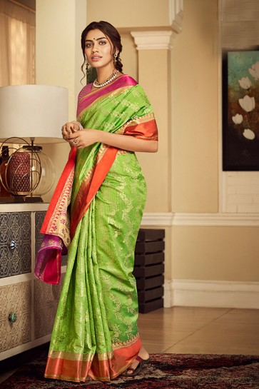 Pretty Weaving Work And Jacquard Work Light Green Banarasi Silk Saree With Border Work Blouse