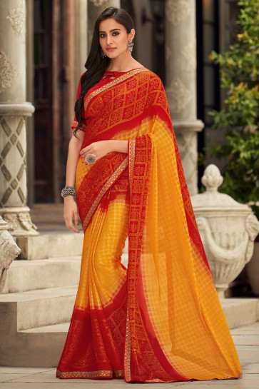 Chiffon Fabric Yellow And Red Embroidered Designer Saree And Blouse