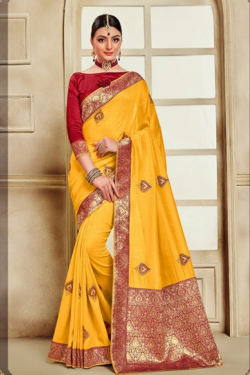 Delicate Embroidered And Jaquard Work Designer Yellow Silk Fabric Saree With Border Work Blouse