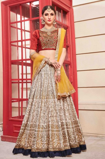 Dazzling Cream Embroidered And Hand Work Silk Lehenga Choli And Dupatta