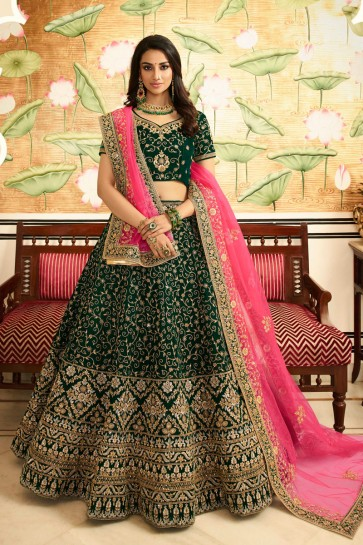 Green Velvet Fabric Embroidered And Stone Work Designer Lehenga Choli And Dupatta