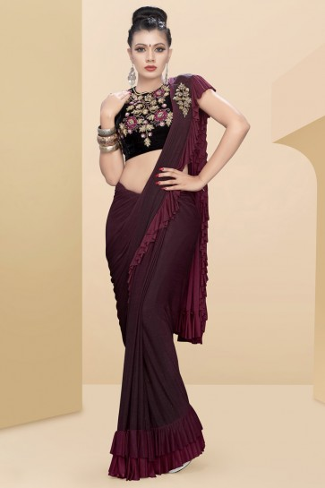 Marvelous Lycra Fabric Thread Work And Sequins Work Maroon Flare Saree With Velvet Blouse