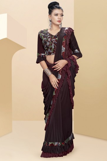 Delicate Sequins And Thread Work Maroon Lycra Flare Saree With Art Silk Blouse