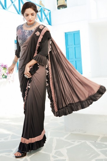 Lycra Fabric Chikoo And Black Sequins And Thread Work Designer Flare Saree And Blouse