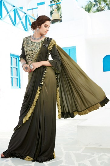 Supreme Sequins And Thread Work Mehendi Green Lycra Flare Designer Saree And Blouse
