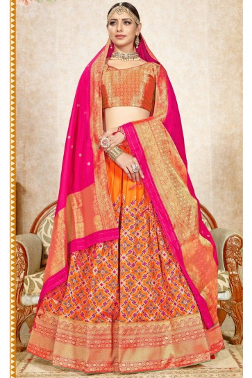 Orange Jacquard Work And Weaving Work Banarasi Silk Fabric Lehenga Choli And Dupatta