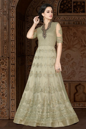 Lovely Beige Embroidery Worked Salwars Suit with Net Dupatta