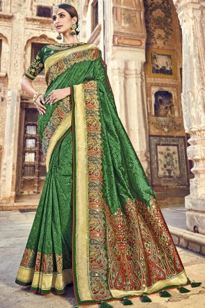 Party Wear Banarasi Silk Fabric Green Embroidery And Lace Work Designer Saree And Blouse