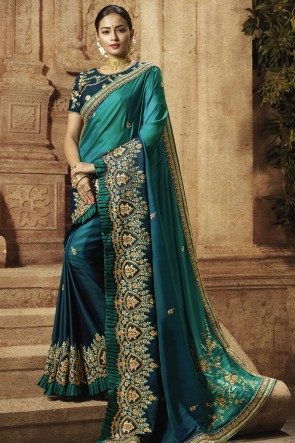 Teal Silk Fabric Border Work And Embroidered Designer Saree And Blouse