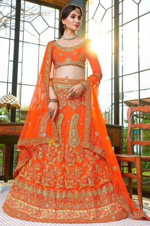 Graceful Orange Net Embroidred And Stone Work Lehenga With Embroidred Blouse