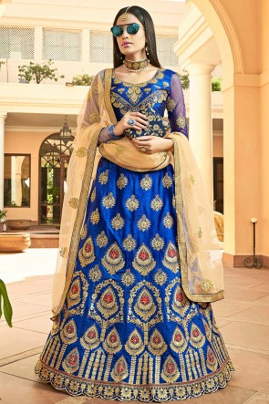 Dazzling Royal Blue Embroidred And Zari Work Silk Lehenga Choli With Net Dupatta